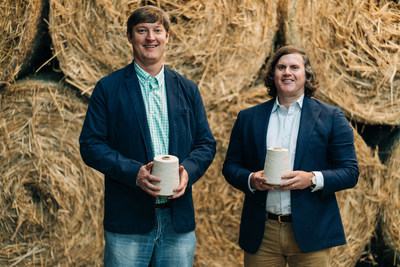 CEO, Coleman Beale and Managing Director, Austin Bryant pictured in BastCore's bale room holding cones of yarn processed through the company's proprietary technology system. BastCore buys hemp stalks and sells fiber products, bridging the gap between farmers growing hemp and industries demanding cost-competitive, sustainably produced raw materials.